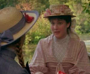 Diana Barry and Anne Shirley wearing excellent hats.