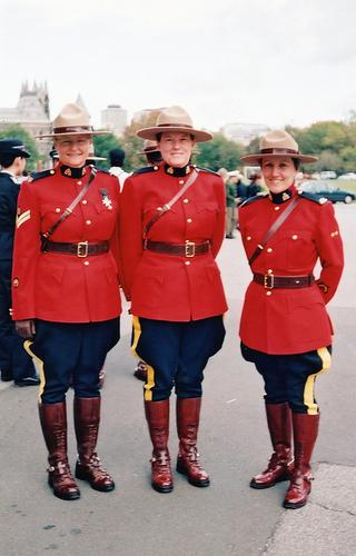 Three female mounties in full uniform.