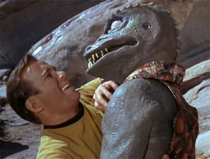 Captain Kirk wrestling a lizardy alien. I'm sure the Internet will tell me which one.