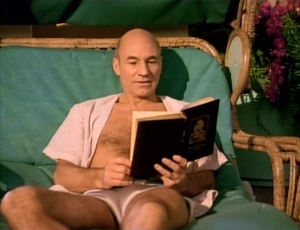 Captain Picard in shorts reading a book.