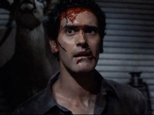 Bruce Campbell looking bloodied and confused.