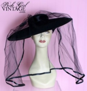 wide-brimmed black hat with veil