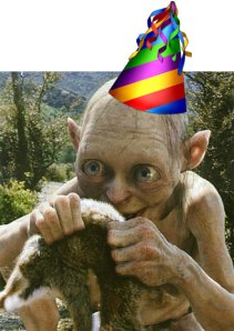 smeagol with a party hat holding a rabbit