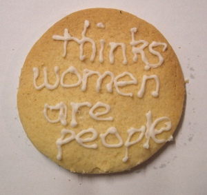 "Feminist cookie with icing that says ""thinks women are people."""