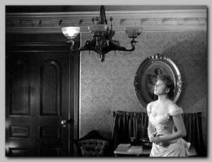 A scene from the movie gaslight, with Ingrid Bergman looking up at a flickering lamp.