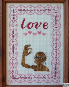 An embroidered sampler of Smeagol loving the Ring