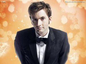 David Tennant as the 10th Doctor Who, looking full of mischief and charm.