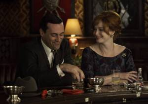 Don and Joan from Mad Men sitting in a bar together.