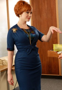 Joan Holloway from Mad Men, holding out her hand.