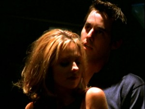 Buffy teasing Xander on the dance floor.