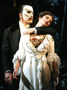 The Phantom of the Opera behind Christine.