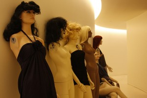 Mannequins in the hallway, waiting to be put away.