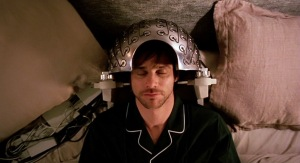 Joel from Eternal Sunshine with the memory-wiping colander on his head.