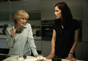 Patty Hewes and Ellen from Damages, in the breakroom drinking coffee.