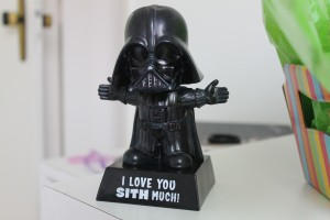 "Toy Darth on a pedestal that says ""I love you Sith much!"""