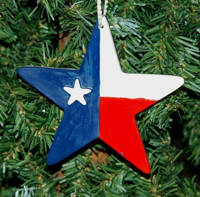 A christmas ornament that combines a star and the Texas flag.