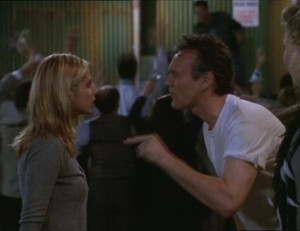 Giles and Buffy from the Band Candy episode. He's smoking and dressed ridiculously.
