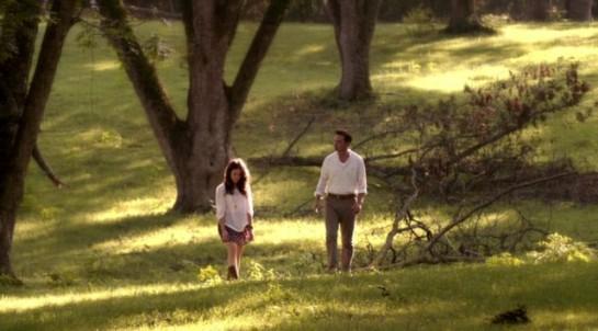 Amantha & Daniel walk in a field on Rectify