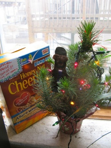 A tiny Christmas tree with Omar finger puppet