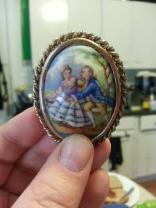 An antique brooch with a woman being bored by a man in art history (a la The Toast)