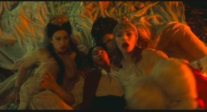 Dracula's daughters feeding on Jonathan Harker in Bram Stoker's Dracula