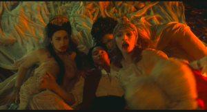 Dracula's daughters feeding on Jonathan Harker in Bram Stoker's Dracula