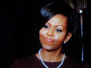 Michelle Obama with a fake smile.