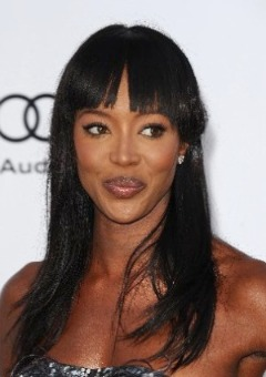 Naomi Campbell with a fake smile.