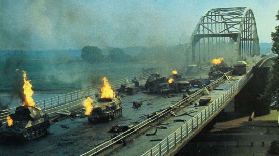 A scene from the Sean Connery movie A Bridge Too Far. It's covered with burning cars and tanks and rubble.