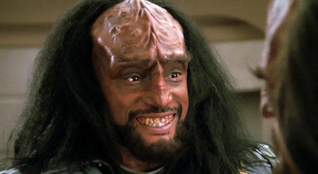 Klingon smiling a toothy smile