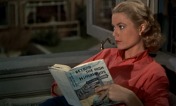 Image: Grace Kelly in jeans and a sporty red shirt, reading a book about the Himalayas.