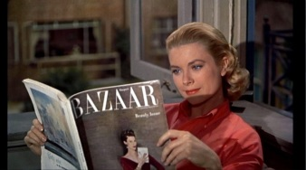 Image: Grace Kelly in the same sporty jeans outfit, secretly and happily reading a copy of Harper's Bazaar.