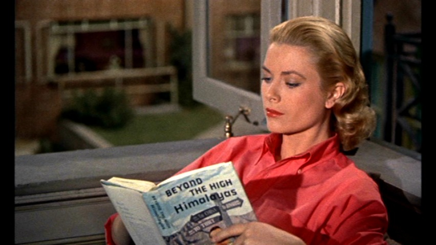 grace kelly reading magazine